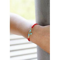 Bracelet doré rouge œil turc femme - porté